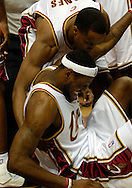 PHOTO BY DAVID RICHARD.LeBron James grimaces after taking a flagrant foul to the head last night against Dallas.