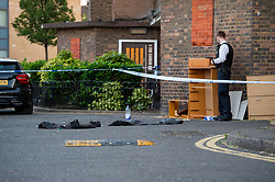 © Licensed to London News Pictures. 20/07/2020. London, UK. Clothes lay on the ground as police launch an investigation after two people were stabbed in Tower Hamlets. Photo credit: Peter Manning/LNP