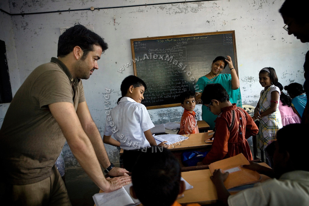 Jaume Sanllorente, the director general of Sonrisas de Bombay is overseeing a lesson at a school run by the fast-growing Spanish NGO in Mumbai, India.