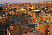 Cairo, Egypt. Neighborhood bordering the city of the dead. Note blue cemetery monuments in the center.