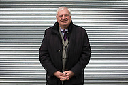 'Untitled, 2014' from the project 'The Fall and Rise of Ravenscraig' by photographer Colin McPherson.<br /> <br /> The photograph shows former Ravenscraig steelworker Terry Currie, who became an executive at Scottish Enterprise, pictured outside the Ravenscraig Regional Sports Facility, built in 2010 on the site of the former steelworks.<br /> <br /> This project, photographed in 2014, looks at the topography of the post-industrial landscape at Ravenscraig, the site until its closure in 1992 of the largest hot strip steel mill in western Europe. In its current state, Ravenscraig is one of the largest derelict sites in Europe measuring over 1,125 acres (4.55 km2) in size, an area equivalent to 700 football pitches or twice the size of Monaco. It is currently being developed with a mix of housing, retail and the home of South Lanarkshire College and the Ravenscraig Regional Sports Facility.