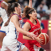 TOKYO, JAPAN August 8:  Rui Machida #13 of Japan drives to the basket defended by Sue Bird #6 of the United States during the Japan V USA basketball final for women at the Saitama Super Arena during the Tokyo 2020 Summer Olympic Games on August 8, 2021 in Tokyo, Japan. (Photo by Tim Clayton/Corbis via Getty Images)