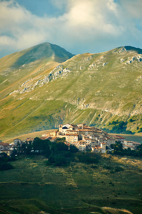 The hill town  of Castelluccio di Norcia, Parco Nazionale dei Monti Sibillini ,  Apennine Mountains,  Umbria, Italy. .<br /> <br /> Visit our ITALY HISTORIC PLACES PHOTO COLLECTION for more   photos of Italy to download or buy as prints https://funkystock.photoshelter.com/gallery-collection/2b-Pictures-Images-of-Italy-Photos-of-Italian-Historic-Landmark-Sites/C0000qxA2zGFjd_k