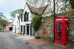 The Cramond Inn and red telephone box in village of Cramond in Edinburgh, Scotland, UK