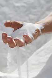 sand slipping through a man's hand