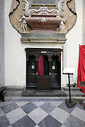 confessional under a tomb monument, Duomo, Città di Castello, Umbria, Italy