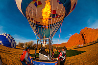 Inflating hot air balloons at the Red Rock Balloon Rally, Red Rock State Park, near Gallup, New Mexico USA.