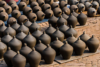 Before firing in the kiln pottery sits in the sun to dry, Pottery Square, Bhaktapur, Kathmandu Valley, Nepal.