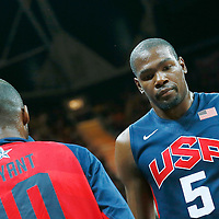 06 August 2012: USA Kevin Durant is congratulated by Kobe Bryant during 126-97 Team USA victory over Team Argentina, during the men's basketball preliminary, at the Basketball Arena, in London, Great Britain.