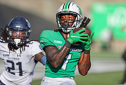 Oct 9, 2021; Huntington, West Virginia, USA; Marshall Thundering Herd wide receiver Willie Johnson (1) catches a touchdown late in the fourth quarter against the Old Dominion Monarchs at Joan C. Edwards Stadium. Mandatory Credit: Ben Queen-USA TODAY Sports