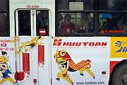© Licensed to London News Pictures. 30/12/2011. A young woman stands on a public bus in Hanoi,  Vietnam. Photo credit : Stephen Simpson/LNP
