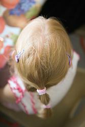 Top of head of nursery school girl,