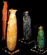 Group of alabaster (perfume bottles) from Kamiros, 7th-6th century BC.  1.Alabaster alabastron (perfume bottle), 2. Terracotta alabastron, made in Ionia, 3. Core-formed glass alabastron, made on Rhodes or Mesopotamia, 4. Faience alabastron made on Rhodes.