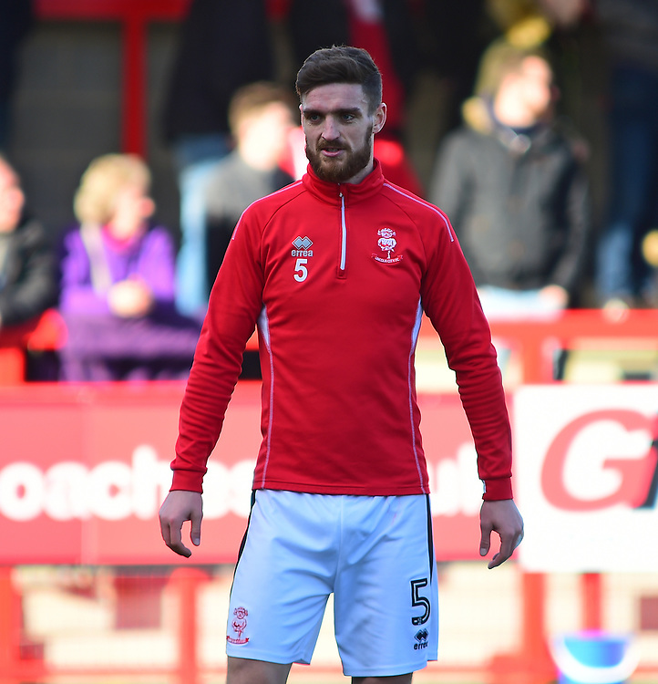 Lincoln City's Luke Waterfall during the pre-match warm-up<br /> <br /> Photographer Andrew Vaughan/CameraSport<br /> <br /> The EFL Sky Bet League Two - Crawley Town v Lincoln City - Saturday 17th February 2018 - Broadfield Stadium - Crawley<br /> <br /> World Copyright © 2018 CameraSport. All rights reserved. 43 Linden Ave. Countesthorpe. Leicester. England. LE8 5PG - Tel: +44 (0) 116 277 4147 - admin@camerasport.com - www.camerasport.com
