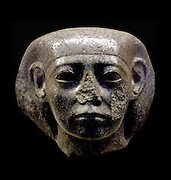 Egyptian sculpture of a head taken from statue of an official. Twelfth Dynasty, (approx. 1850 BC) made of granite.