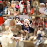 Howell, Mich., resident Vianne Bowman (cq) is framed by a display of dolls as she looks around during the Toledo Doll & Bear Show & Sale hosted at the Lucas County Recreation Center in Maumee, Ohio, on Sunday, Nov. 17, 2019. THE BLADE/KURT STEISS<br /> CTY DOLLSHOW18<br /> <br /> <br /> Note: This one is my personal favorite.