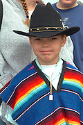 Cinco de Mayo parade spectator with black hat age 11.  St Paul Minnesota USA