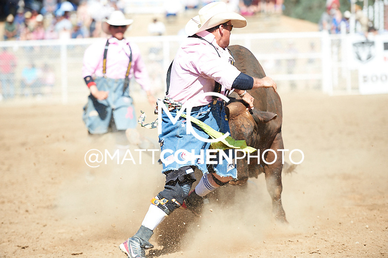 Bullfighter Donny Castle battles C06 at the Woodlake Lions Rodeo.<br /> <br /> <br /> UNEDITED LOW-RES PREVIEW<br /> <br /> <br /> File shown may be an unedited low resolution version used as a proof only. All prints are 100% guaranteed for quality. Sizes 8x10+ come with a version for personal social media. I am currently not selling downloads for commercial/brand use.