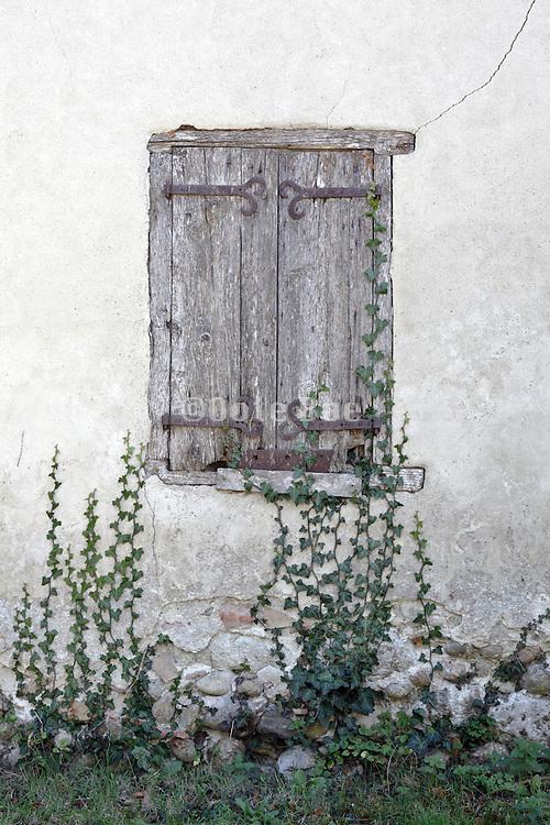 old deteriorating wooden window shutters