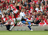 Photo: Chris Ratcliffe.<br />Arsenal v Middlesbrough. The Barclays Premiership. 09/09/2006.<br />Stewart Downing of Middlesbrough clashes with Emmanuel Eboue of Arsenal.