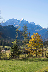 Scenic view of autumn landscape and snowcapped mountain in Bavarian alps, Alpspitz, Wetterstein Mountain, Bavaria, Germany