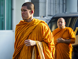 November 3, 2018 - Bangkok, Bangkok, Thailand - Buddhist monks walk into Wat Debsirin on the first day of funeral rites for Vichai Srivaddhanaprabha. Vichai was the owner of King Power, a Thai duty free conglomerate, and the Leicester City Club, a British Premier League football (soccer) team. He died in a helicopter crash in the parking lot of the King Power stadium in Leicester after a match on October 27. Vichai was Thailand's 5th richest man. The funeral is expected to last one week. (Credit Image: © Sean Edison/ZUMA Wire)