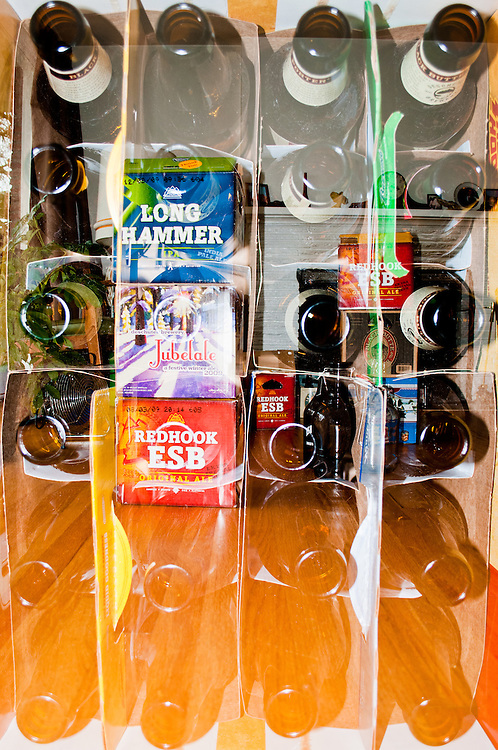 A double exposure f beer bottles and beer cases.