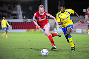 Tyrone Williams of Kidderminster and Mark Beck of Wrexham on loan from Yeovil Town during the Vanarama National League match between Wrexham AFC and Kidderminster Harriers at the Glyndŵr University Racecourse Stadium, Wrexham, United Kingdom on 23 February 2016. Photo by Mike Sheridan.