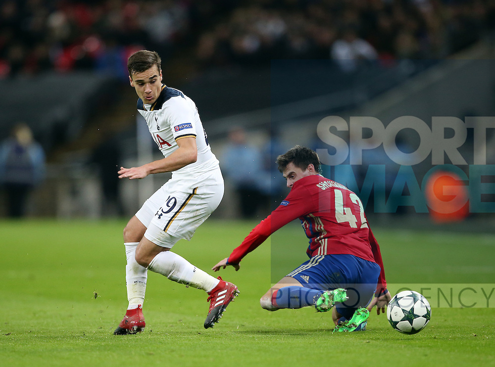 Tottenham's Harry Winks tussles with CSKA Moscow's Georgi Schennikov during the Champions League group match at Wembley Stadium, London. Picture date December 7th, 2016 Pic David Klein/Sportimage