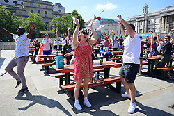© Licensed to London News Pictures. 13/06/2021. London, UK. Fans react to England scoring and going 1-0 up. Fans gather in the Fan Zone at Trafalgar Square in central London for England's opening game of the 2020 European Championship against Croatia. Photo credit: Ben Cawthra/LNP
