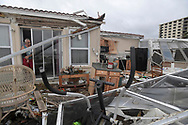 Homeowner Joe Lovece surveys the damage to the kitchen at the back of his oceanfront home after the eye of Hurricane Matthew passed Ormond Beach, Florida, U.S. October 7, 2016. Lovece rode out the storm as waves took away the room at the back of his home.  REUTERS/Phelan Ebenhack