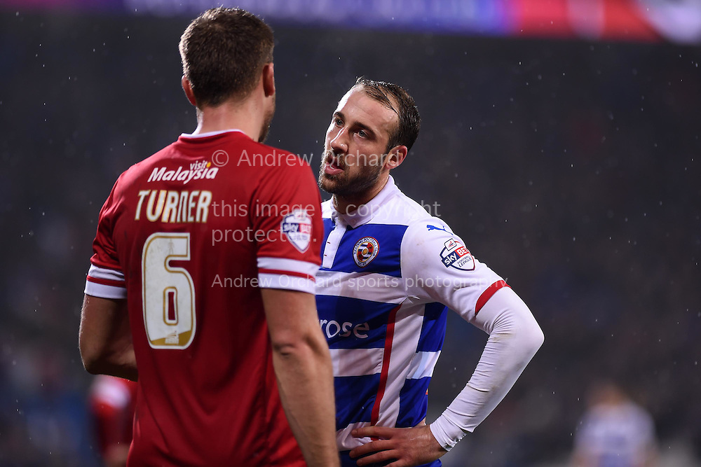 Glen Murray of Reading ® has words with Ben Turner of Cardiff city. Skybet football league championship match, Cardiff city v Reading at the Cardiff city stadium in Cardiff, South Wales on Friday 21st November 2014<br /> pic by Andrew Orchard, Andrew Orchard sports photography.