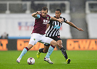 Football - 2021 / 2021 Premier League - Newcastle United vs Burnley - St Jame's Park<br /> <br /> Chris Wood of Burnley FC vies with Isaac Hayden of Newcastle United<br /> <br /> COLORSPORT/BRUCE WHITE