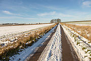 Winter landscape scenery with snow countryside track road, near Yatesbury, Wiltshire, England, UK