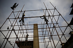 April 18, 2018 - Kathmandu, Nepal - Workers labor on top of a scaffolding at a monument damaged after the April 25, 2015 earthquake on the occasion of International Day for Monuments and Sites or World Heritage Day to raise awareness and preserve it for future generations in Hanumandhoka Durbar Square, a UNESCO heritage site in Kathmandu, Nepal on Wednesday, April 18, 2018. (Credit Image: © Skanda Gautam via ZUMA Wire)