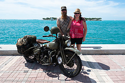 Randy Samz with his partner and his 1942 Harley-Davidson WLA at the end of the Cross Country Chase motorcycle endurance run from Sault Sainte Marie, MI to Key West, FL. (for vintage bikes from 1930-1948). The Grand Finish in Key West's Mallory Square after the 110 mile Stage-10 ride from Miami to Key West, FL and after covering 2,368 miles of the Cross Country Chase. Sunday, September 15, 2019. Photography ©2019 Michael Lichter.