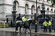 Police on horseback patrol by the front door of UK Prime Minister's office as British authorities unboxed the Winston Churchill statue in Parliament Square in central London on Thursday, June 18, 2020, prior to a visit of the French President Emmanuel Macron to London. (Photo/ Vudi Xhymshiti)