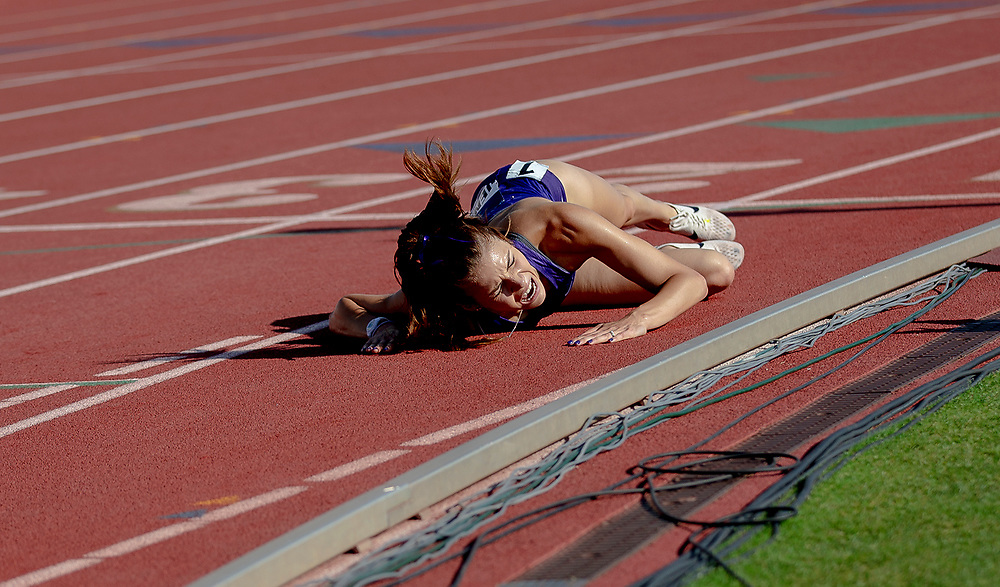 Furman's Gabrielle Jennings collapses to the track after finishing the women's 3,000-meter steeplechase during the NCAA outdoor track and field championships Saturday, June 8, 2019, in Austin, Texas. NICK WAGNER / AMERICAN-STATESMAN