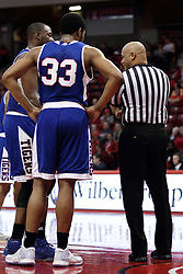 22 December 2015: Official Ed Crenshaw speaks with a pair of Tigers including Wayne Martin(33). Illinois State Redbirds host the Tennessee State Tigers at Redbird Arena in Normal Illinois (Photo by Alan Look)