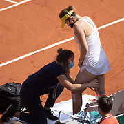 PARIS, FRANCE June 12.  Anastasia Pavlyuchenkova of Russia receives treatment during her match against Barbora Krejcikova of the Czech Republic on Court Philippe-Chatrier during the final of the singles competition at the 2021 French Open Tennis Tournament at Roland Garros on June 12th 2021 in Paris, France. (Photo by Tim Clayton/Corbis via Getty Images)
