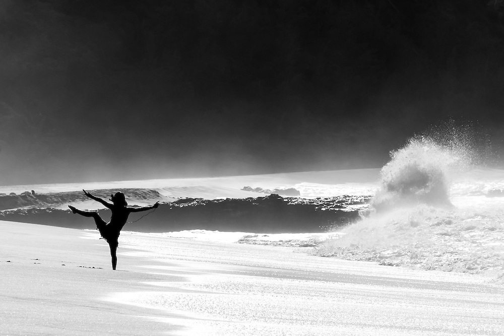 A human silhouette dancing with the sea on Secret Beach, Kauai