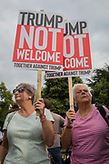 Women protestors outside a temporary perimeter fence encircling Winfield House, the official residence of the US Ambassador during the visit to the UK of US President, Donald Trump, on 12th July 2018, in Regents Park, London, England.