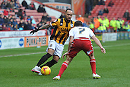 Byron Moore of Port Vale and Sheffield United midfielder Ryan Flynn  during the Sky Bet League 1 match between Sheffield Utd and Port Vale at Bramall Lane, Sheffield, England on 20 February 2016. Photo by Ian Lyall.