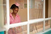 Portrait of nurse in pink uniform at Rees Immunization Clinic, Musoto, Mbale, Uganda