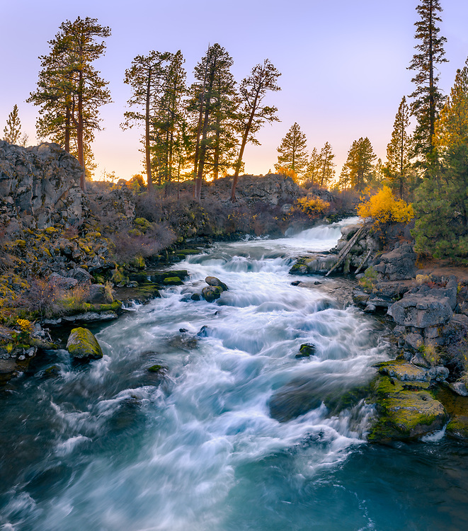 A low angle aerial view over Dillon Falls reveals the beauty and power of the aqua colored waters of the Deschutes River.