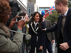 March 8, 2018 - Birmingham, England, United Kingdom - 3/8/18.Meghan Markle talks to local school children during a walkabout with Britain''s Prince Harry during a visit to Birmingham, Britain. (Credit Image: © Starmax/Newscom via ZUMA Press)