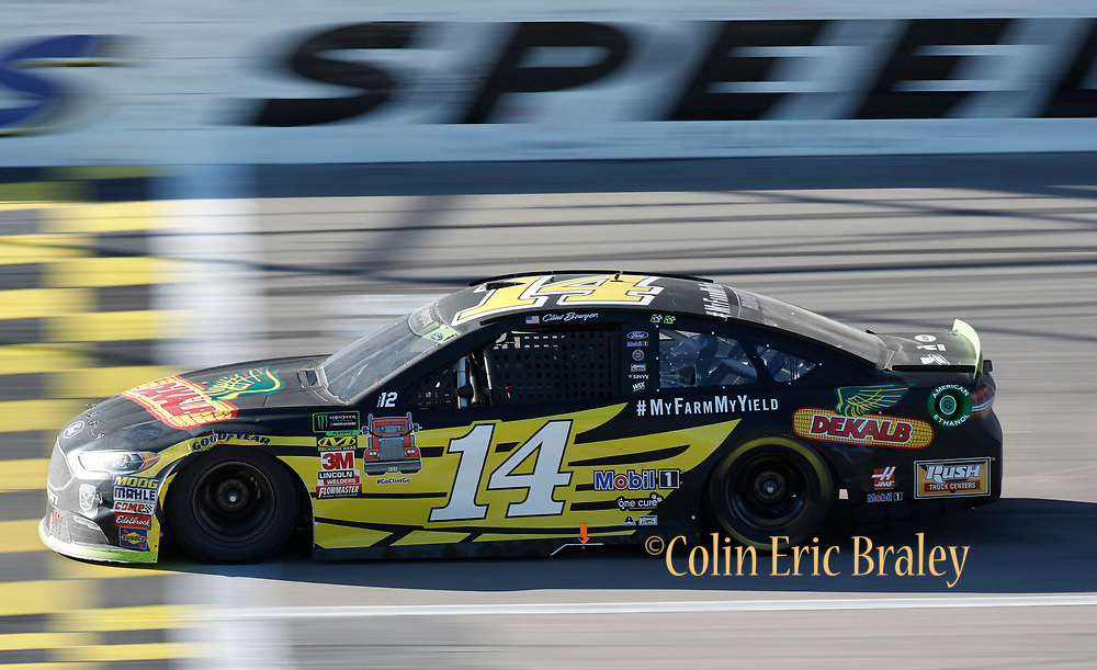 Clint Bowyer (14) heads down the front stretch during a NASCAR Cup Series auto race at Kansas Speedway in Kansas City, Kan., Sunday, Oct 21, 2018. (AP Photo/Colin E. Braley)