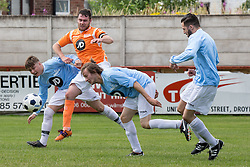 © Licensed to London News Pictures . 02/08/2015 . Droylsden Football Club , Manchester , UK . DANNY MILLER and ELLIOTT TITTENSOR compete for the ball . Celebrity football match in aid of Once Upon a Smile and Debra , featuring teams of soap stars . Photo credit : Joel Goodman/LNP