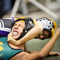 022114  Adron Gardner/Independent<br /> <br /> Miyamura Patriot Toshio Herrera attempts to lock in a choke on Los Alamos Hilltopper Reyes Mendez during the state wrestling championship at the Santa Ana Star Center in Rio Rancho Friday.