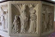 Church of All Saints, Great Glemham, Suffolk, England, UK - Seven Sacrament font depicting ordination